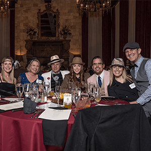 San Diego Murder Mystery party guests at the table
