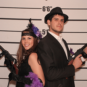 San Diego Murder Mystery party guests pose for mugshots